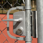 Locinox LUKYJ5 Surface Mounted 'US' Mortise Cylinder Gate Lock Installed On Chain Link Swing Gate