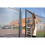 Woman Opening Gate with Locinox Samson 2 Hydraulic Gate Closer Installed
