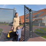 Woman and Child Exiting Gate with Locinox Samson 2 Hydraulic Gate Closer Installed