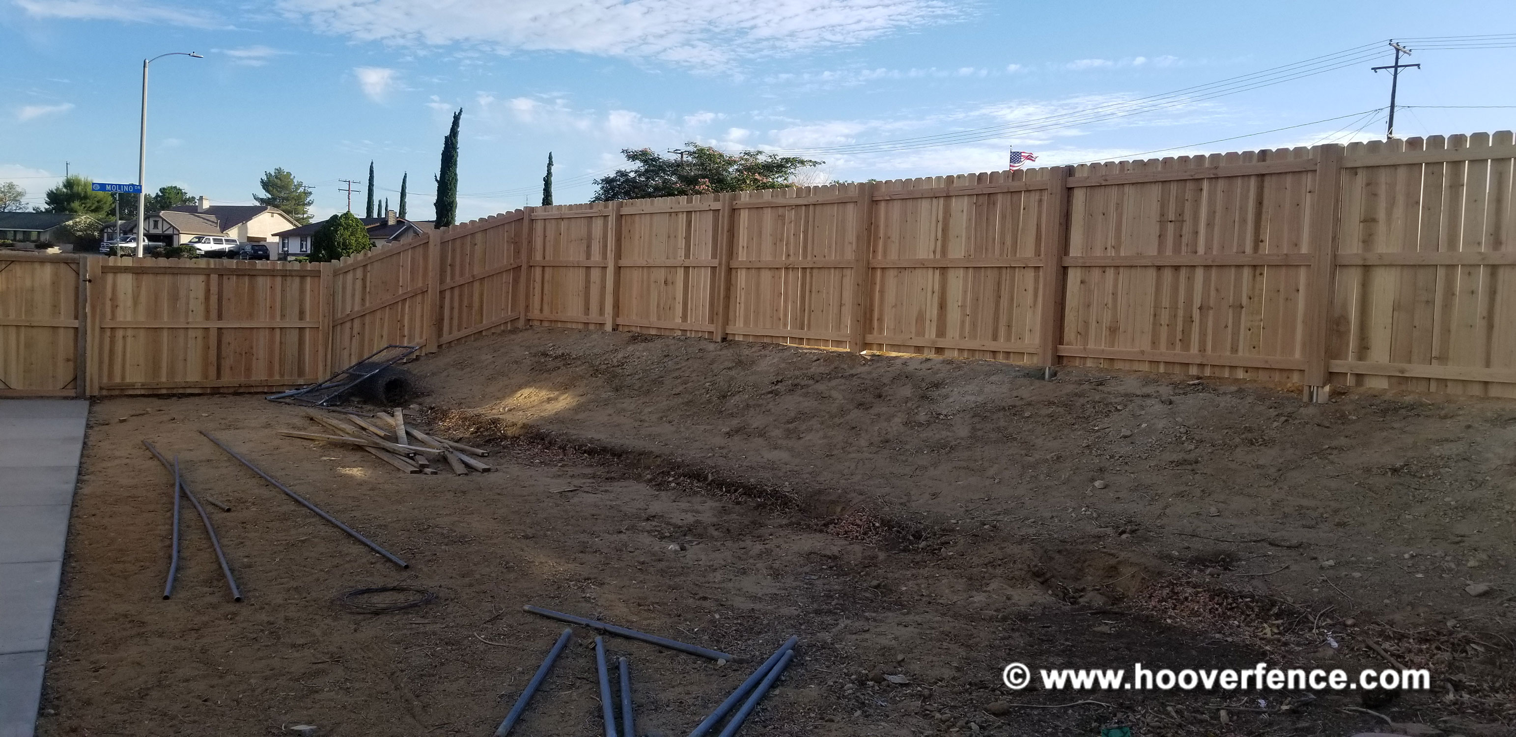 Customer Photo - 6'H Dog Ear Wood Fence Installed with Chain Link Fence Posts and IS-FBL-L Fence Brackets