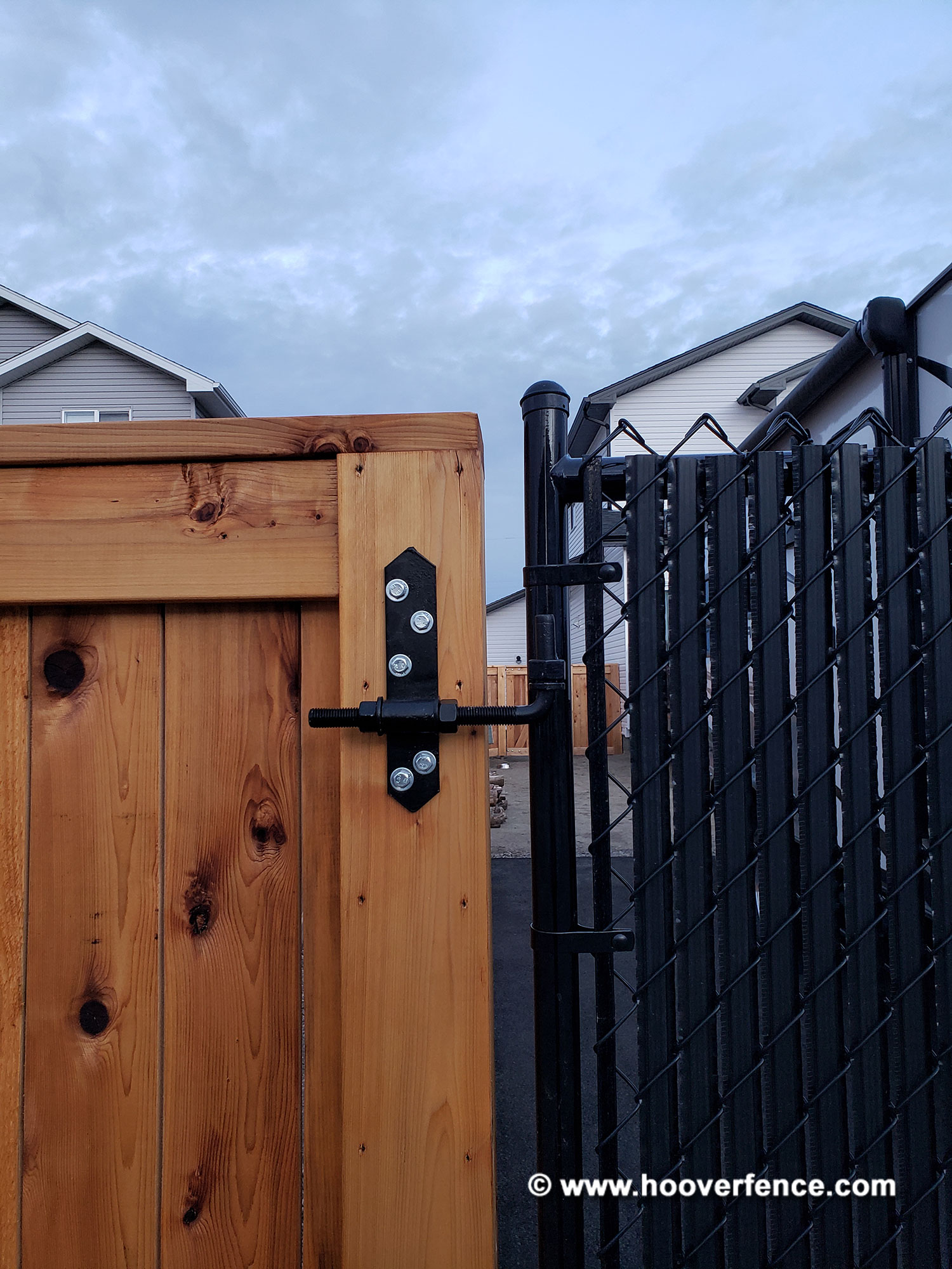 Customer Photo - Black Double Chain Link Gate Installed on Cedar Fence - Alberta, Canada