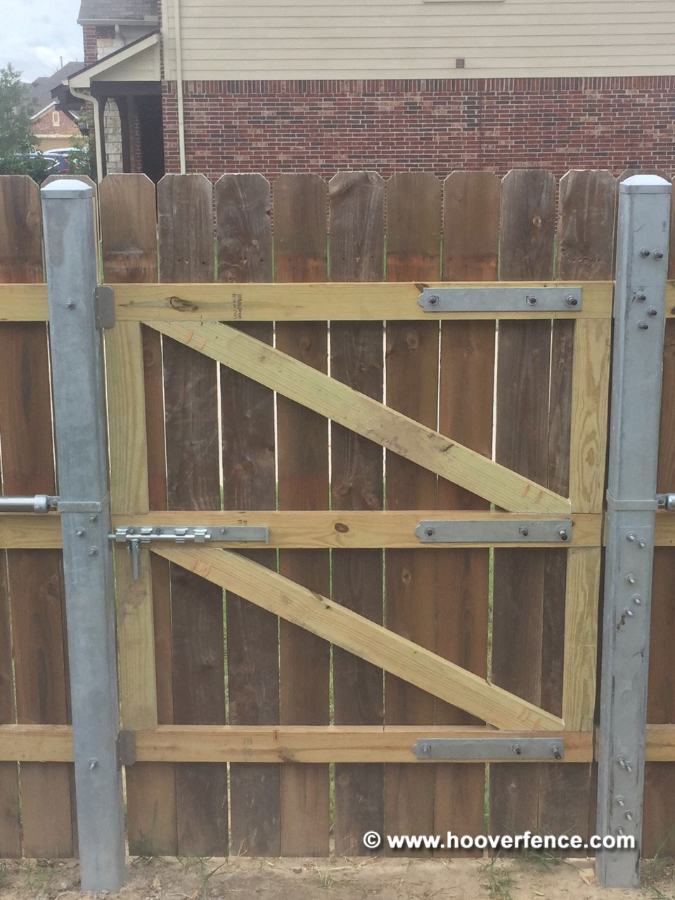 Customer Photo - Solid Dog Ear Wood Gates Hung on 4x4 Steel Posts Using Snug Cottage Hardware