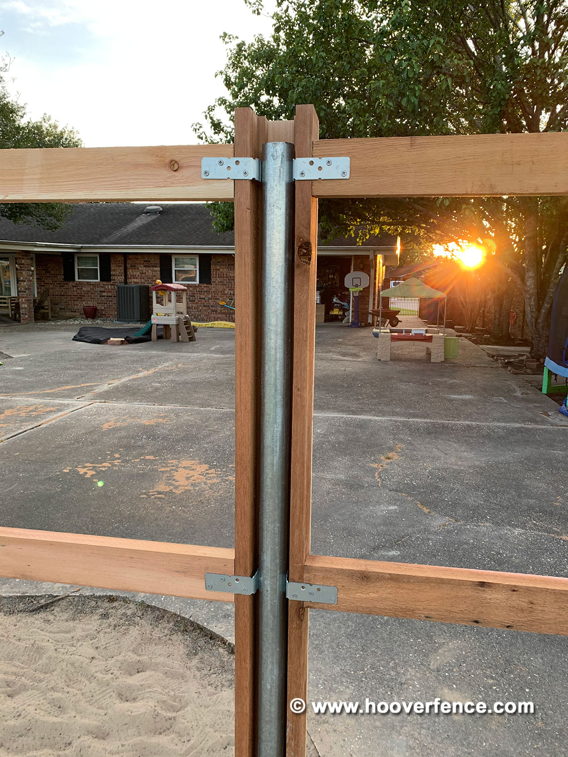 Customer Install - Wood Privacy Fence Installed with 2-3/8 inch Round Steel Posts and OZCO IS-FBL Brackets - Berwick, LA