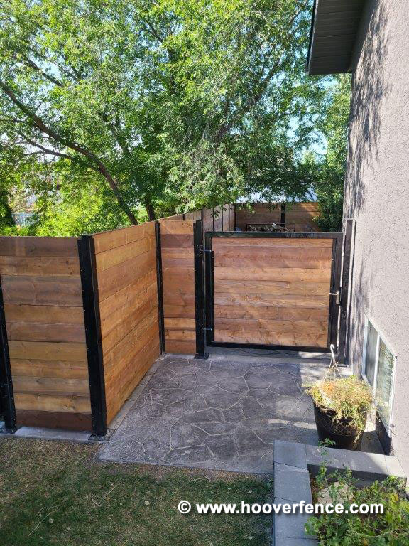 Customer Photo - Horizontal Redwood Privacy Fence with Black Steel Posts and Gate Frames - Secured with Locinox Fortylock - Alberta, Canada